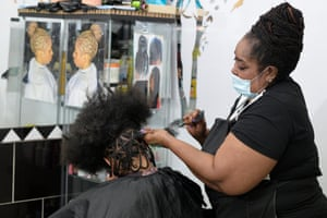 Dee, from E5 Hair Doctor in Clapton, working on Carlos's plaits