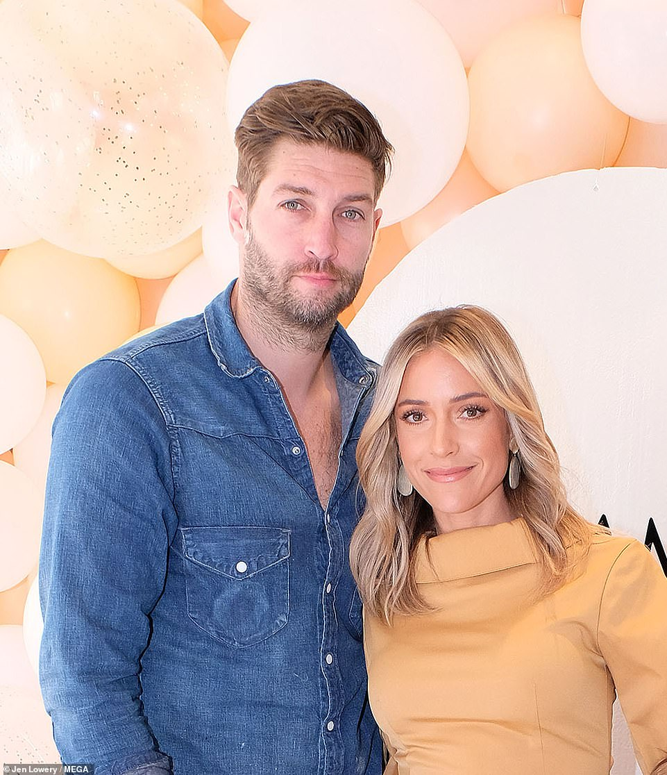Better times: The reality staris in the middle of a divorce from former NFL star husband Jay Cutler, they are seen together last year
