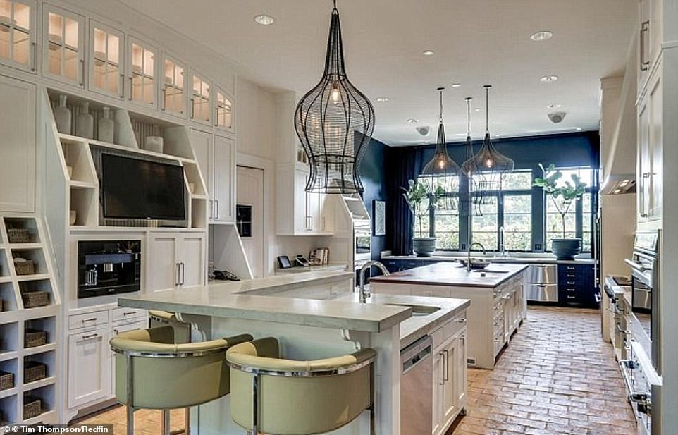Music City munchies: Back in May, the former couple adjusted the asking price to $4.95million only for it to be scooped up this month for 34 percent below that price for $3.7million according to Entertainment Tonight; the kitchen is shown