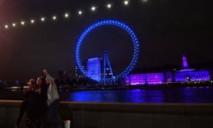 As part of the NHS birthday celebrations The London Eye is illuminated blue on Saturday evening