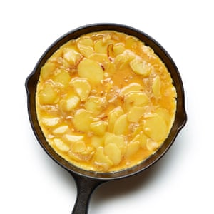 Felicity Cloake's spanish omelette 05. Put the egg and potato mix into a greased pan, and fry until the base is crisp.