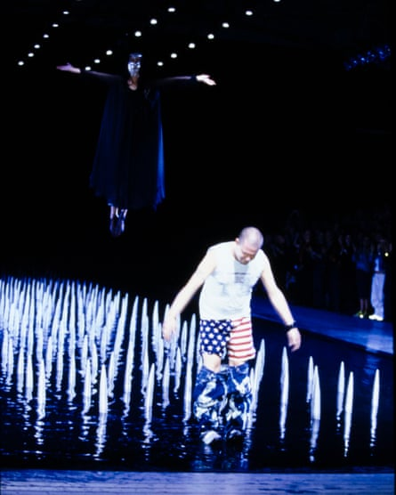 Spikes and the star-spangled banner… Alexander McQueen takes a bow at the end of his spring-summer 2000 ready-to-wear show.