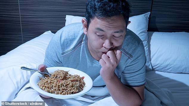 What is clear from many studies is that our bodies don't like having to deal with lots of food late at night. A midnight snack will have a worse impact on you than the same food eaten earlier in the day [File photo]
