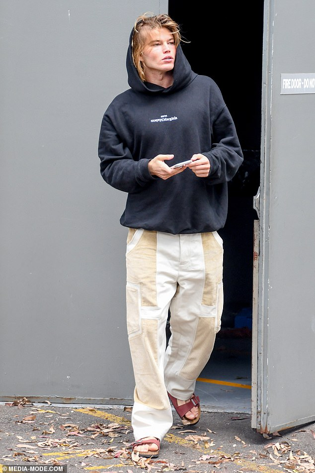Getting to work: On Tuesday, Male supermodel Jordan Barrett showed off his chiseled good looks as he arrived on set of George Maple's theatre production in Sydney