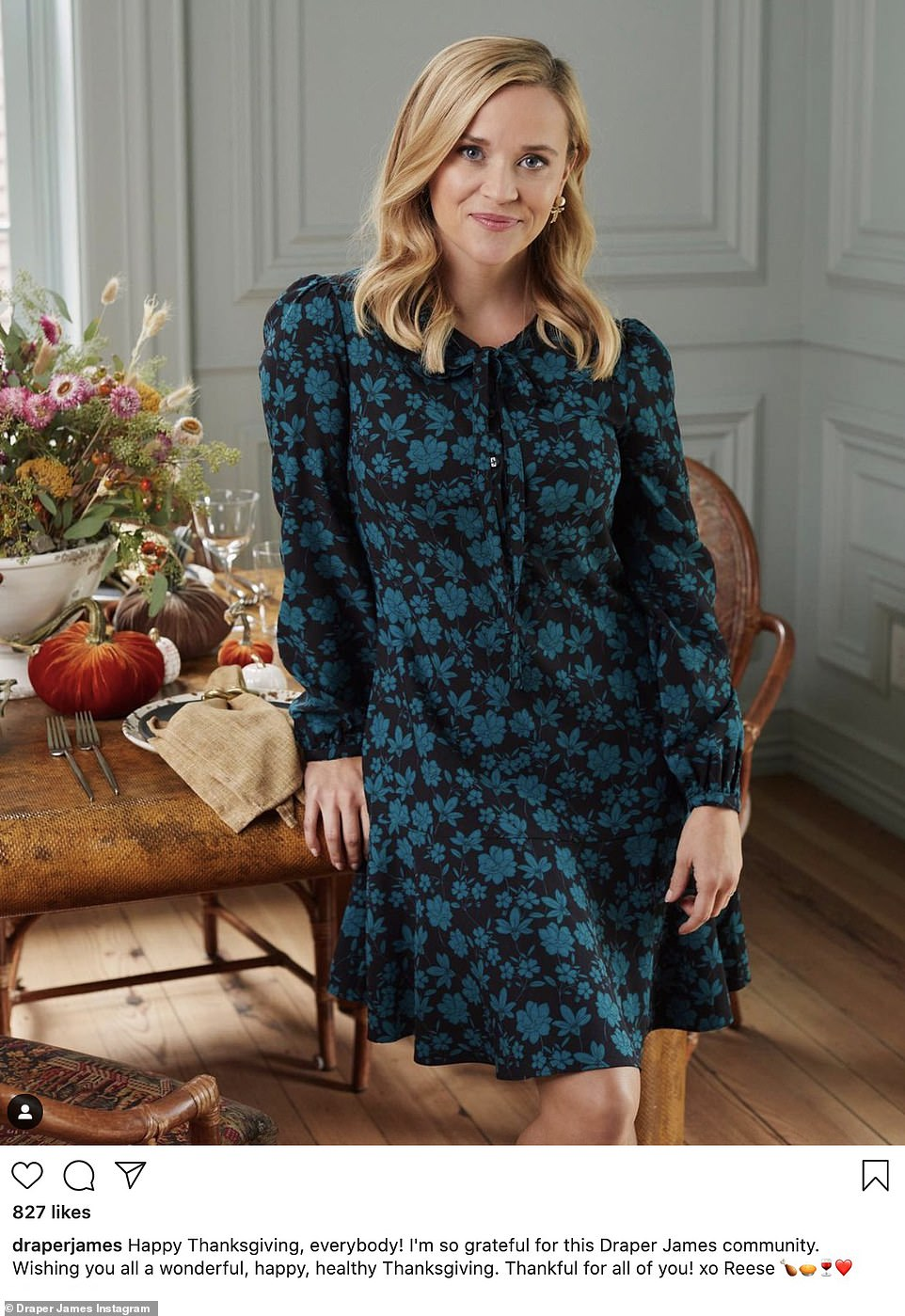 Cheerful: Reese Witherspoon was seen in a green and black dress as she stood in front of her decorated table at home. 'Happy Thanksgiving, everybody!' she said