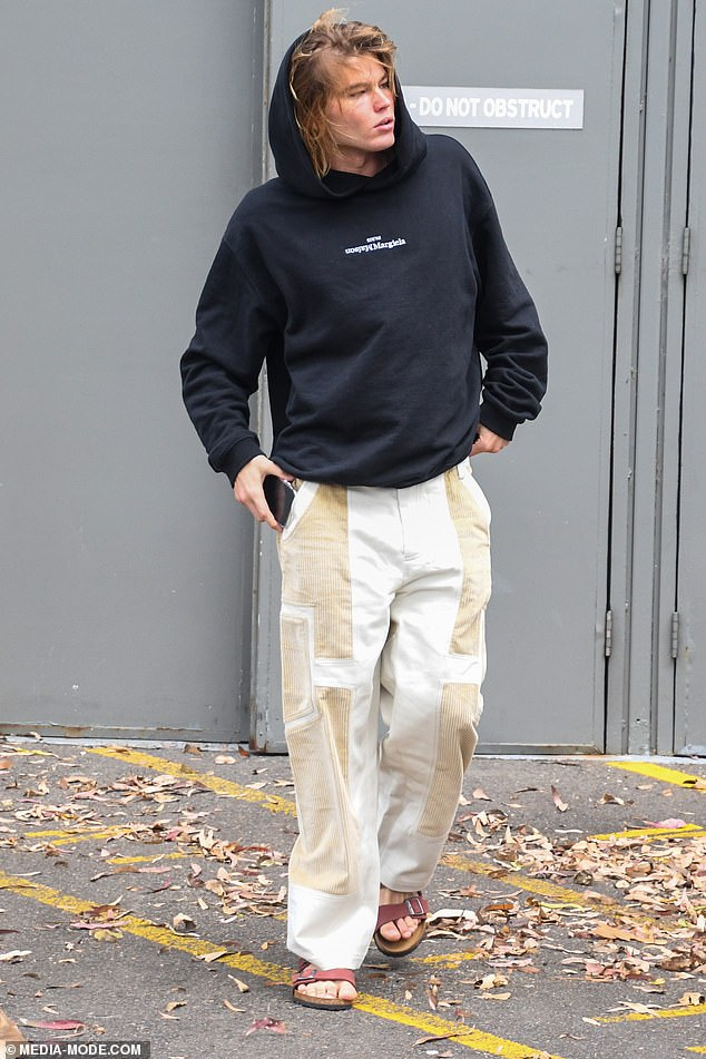 Casual: The 23-year-old showed off his chiseled good looks as he made his way to The Hordern Pavilion, cutting a casual figure in a hooded jumper and baggy trousers