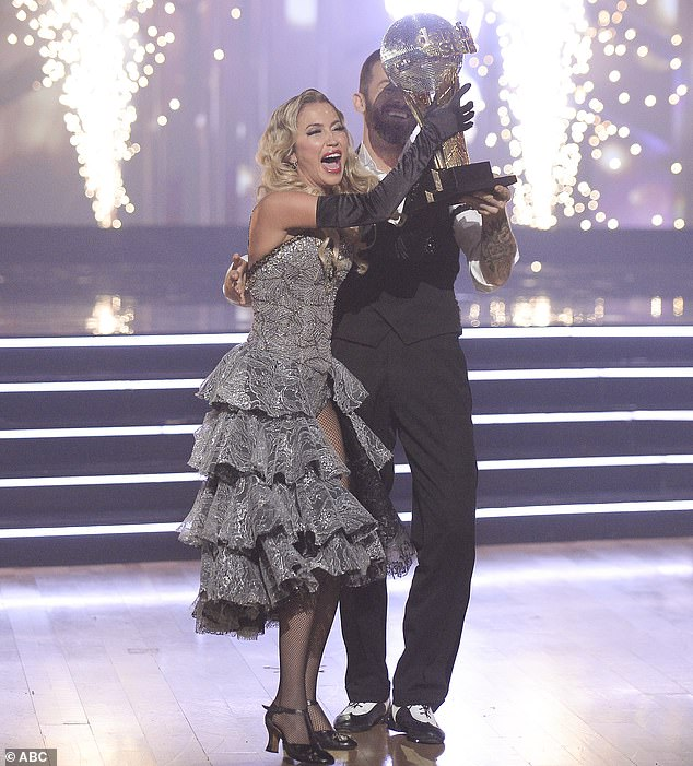 Coveted trophy: The Mirrorball Trophy was held up by Kaitlyn and Artem