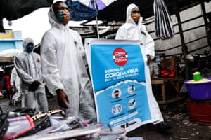 Members of the pro-democracy and civil society movement FILIMBI carry out a public educational campaign about coronavirus in a market in Congo's capital Kinshasa in May.