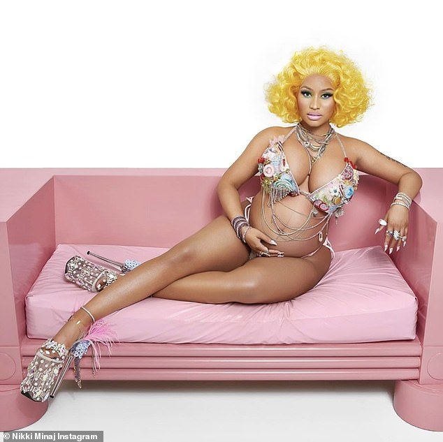 Thankful: 'Marriage. Baby carriage. Overflowing with excitement & gratitude. Thank you all for the well wishes,' captioned the rapper; Nicki pictured in July