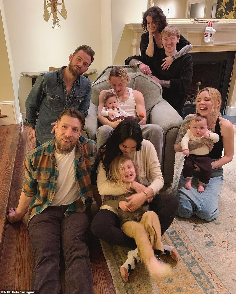 Happy family: Nikki shared this cute snap featuring her twin sister Brie, her WWE champion husband Bryan Danielson, and other family members
