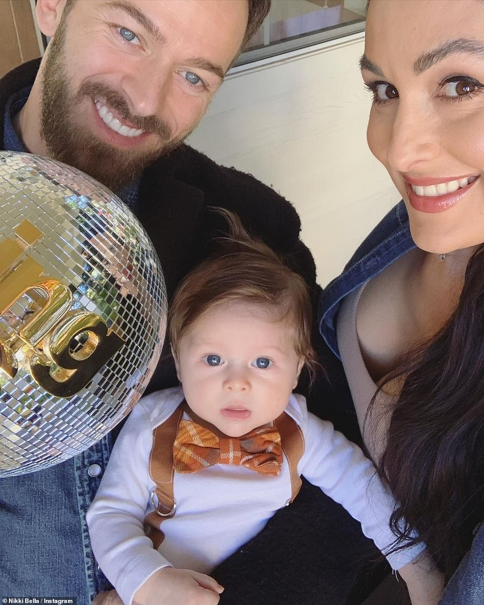 Champion: Matteo isn't the only new addition to the family as Artem showed off his new trophy as he won Dancing With The Stars earlier this week with celebrity partner Kaitlyn Bristowe