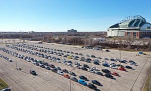 Cars lined up at a testing centre at Miller Park basball stadium in Milwaukee, Wisconsin, as the state reported a seven-day average Covid-19 positivity rate of nearly 40%.