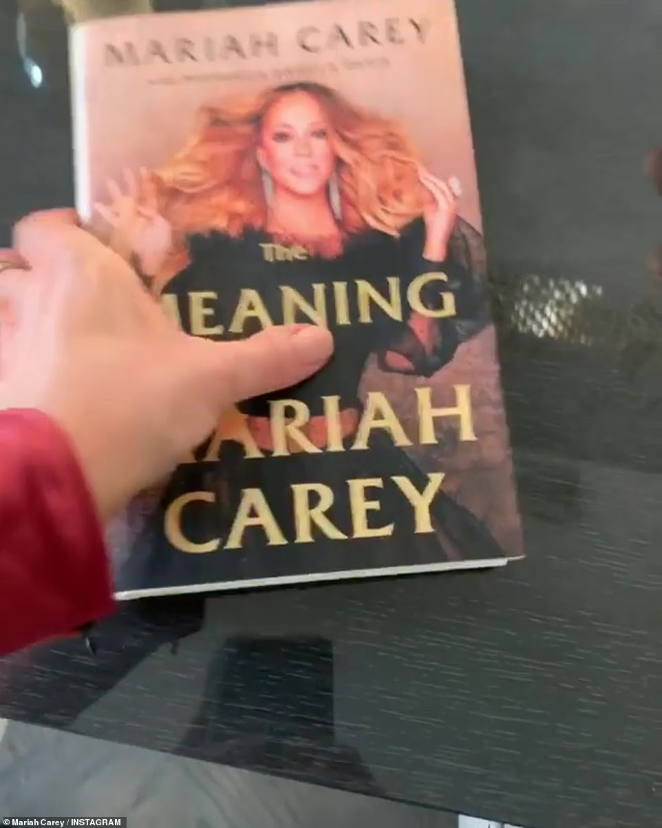 Her own best advert: She also flipped through her recently released memoir