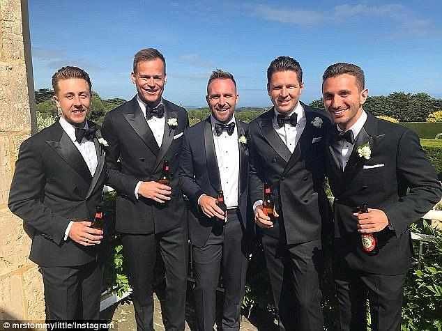Looking sharp:Meanwhile, Lachlan's four groomsmen looked handsome in matching black suits, bow-ties and a floral lapel