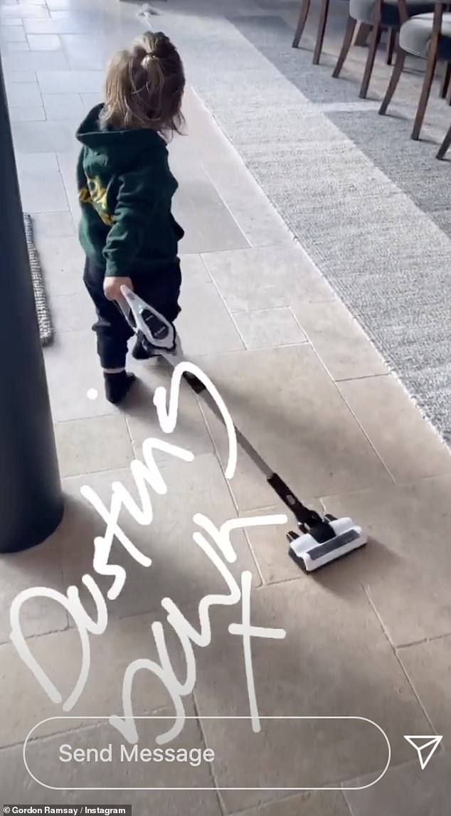 Cute: Oscar was also seen running around the house with a toy hoover, as he pretended to clean the family's Cornish mansion