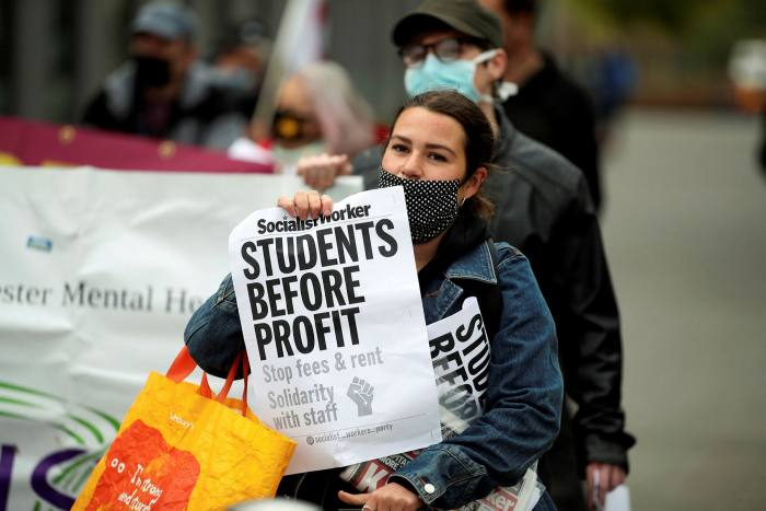 A student protests outside Manchester Metropolitan University. Vicky Blake, president of the University College Union, says 'students have been locked down, locked in, paying high tuition fees, made to feel like biological weapons'