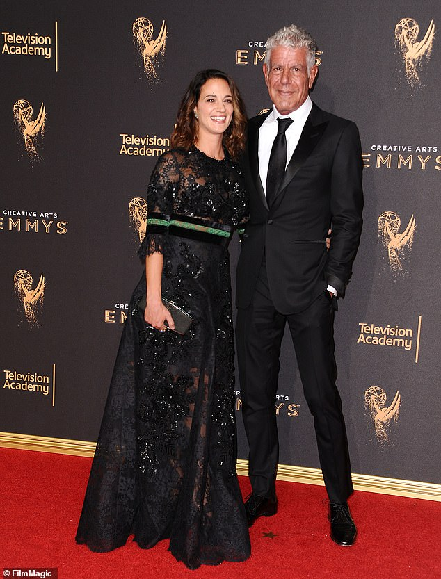 Tragedy: Bourdain, an acclaimed author and host of food and travel shows, died by suicide in 2018 while filming Parts Unknown in France; seen with his partner Asia Argento; seen in 2017