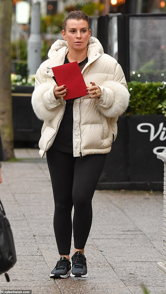 Proud mum: Coleen Rooney headed out in her workout gear on her daily post-gym coffee run in Cheshire on Friday after son Kai, 11, signed for Manchester United