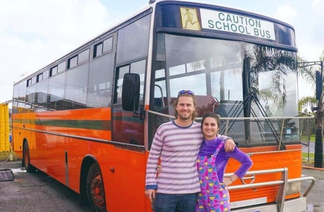 Harry and Hannah Shaw in front of their schoolbus home