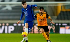 Chelsea's Kai Havertz (left) holds off Ruben Neves of Wolves on 15 December.