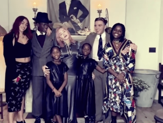 Madonna posing with all six children