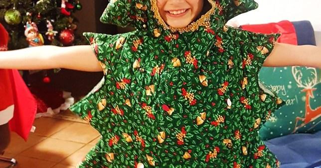 Girl dressed as Christmas tree