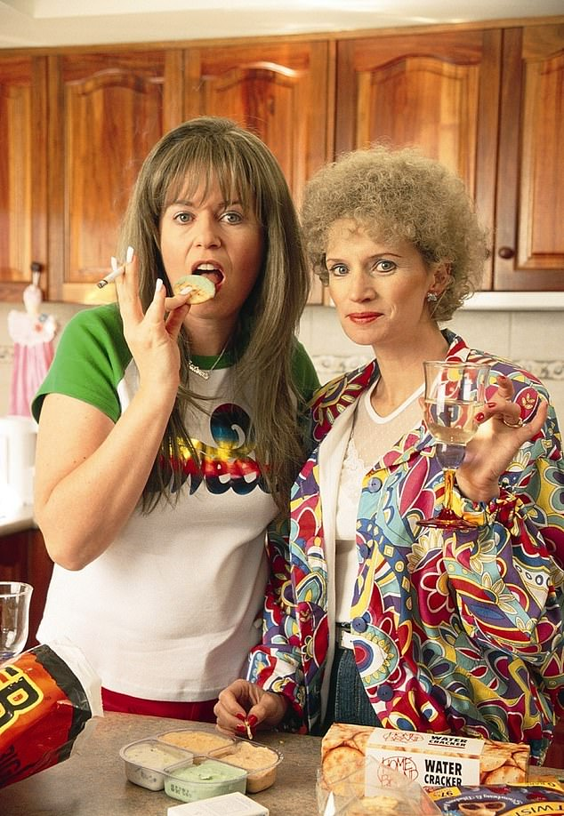 You'll NEVER guess what Gina Riley looks like now! Notoriously private Kath and Kim star, 59, looks almost unrecognisable as she resurfaces to pose alongside her husband and actress daughter in a family photo. Pictured left as Kim Craig on the hit show, with co-star Jane Turner