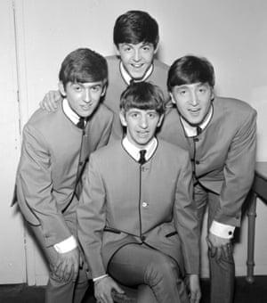The Beatles pose in Pierre Cardin collarless jackets in 1963. (Clockwise from left) George Harrison, Paul McCartney, John Lennon, Ringo Starr.