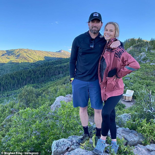 Loved-up: Real Housewives of Orange County alum Meghan King looked blissful on a scenic hike with her new boyfriend Christian Schauft in his native hometown Utah