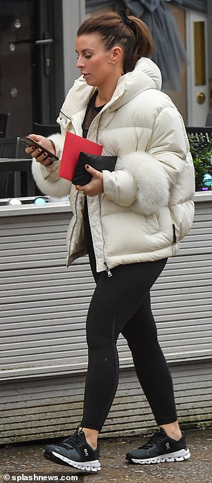Merry Christmas: During her latest outing, Coleen clutched a Christmas card in hand as well as her purse and phone