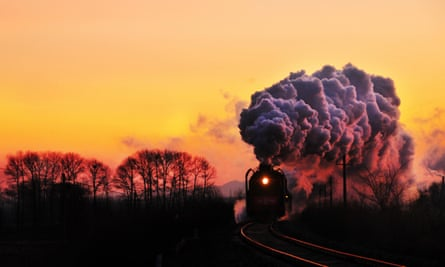 A steam locomotive travels on the railway at sunset in Linxi county, Chifeng city, north Chinas Inner Mongolia