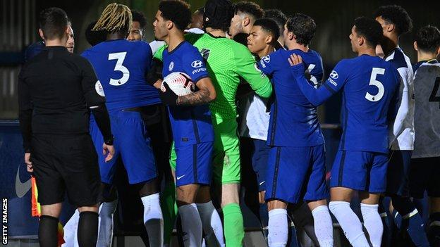 Petr Cech amid a group of shoving players from both teams