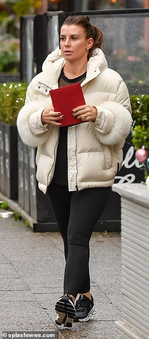 Casual: The mother-of-four, 34, wore black leggings and a matching top with a cream padded coat and trainers as she headed to Costa coffee