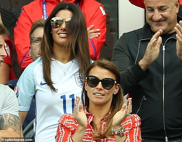 Friendlier times: Rebekah (top) and Coleen watch England v Wales during Euro 2016 at Stade Bollaert-Delelis in Lens, France