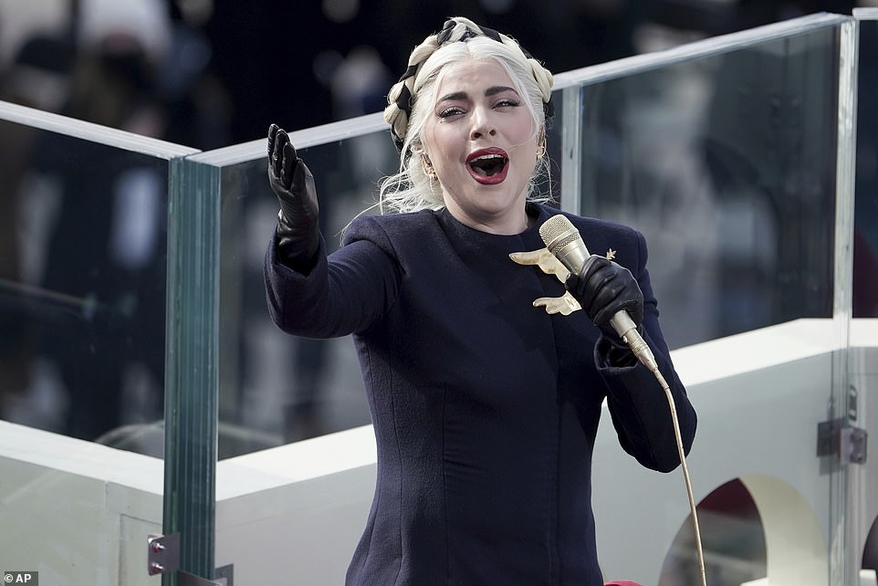 Breathtaking: All eyes were on Lady Gaga as she performed a chill-inducing rendition of the National Anthem during the inauguration of President Joe Biden in Washington DC on Wednesday