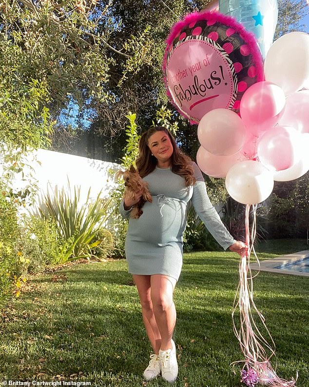 Glowing: Brittany Cartwright celebrated her 32nd birthday on Monday and shares some cute photos of her in a pastel dress in her backyard