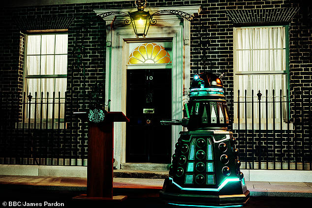 Four Daleks were stationed outside the black front door of No 10, where a uniformed bobby usually stands... They turned on wicked Prime Minister Harriet Walter and zapped her with their ray guns