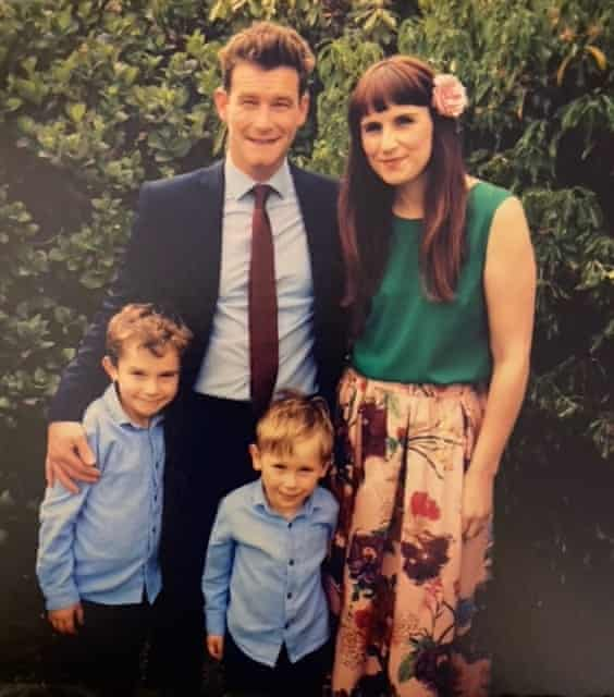 Huw and Naomi at a wedding in 2017 with their sons, Alfie and George.