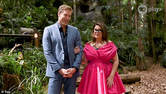 The secret's out! I'm a Celebrity... Get Me Out of Here! Australia viewers have guessed the identity of the show's next intruder. Pictured hosts Chris Brown and Julia Morris