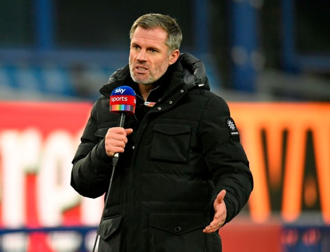 Former player and television pundit Jamie Carragher works pitchside ahead of the English Premier League football match between Everton and Leeds United at Goodison Park in Liverpool, north west England on November 28, 2020.