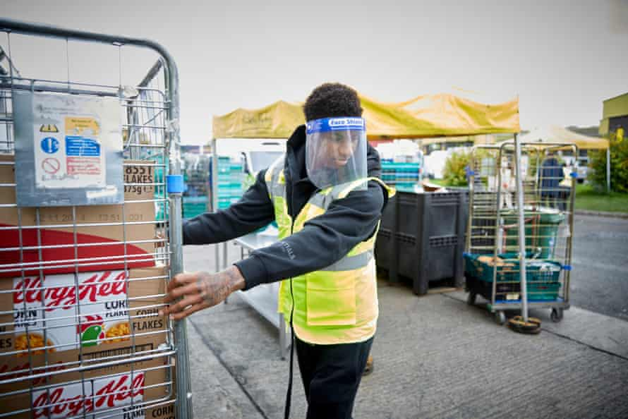 Marcus Rashford helping out with food stocks at a FareShare centre.