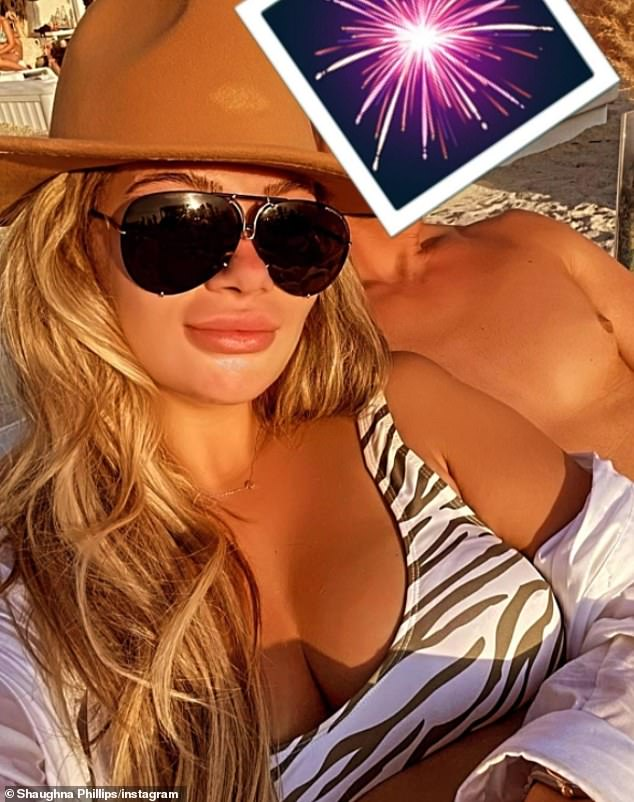 Who is THAT? Love Island 2020 star Shaughna Phillips has baffled her Instagram fans by posting a snap cosying up to a hunky man, claiming she is 'starting 2021 with the same people she started 2020 with'