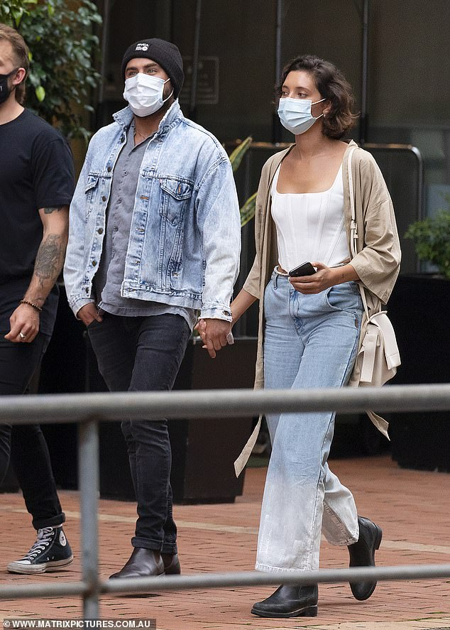 Smitten: On Friday, Zac Efron and girlfriend Vanessa Valladares packed on the PDA and held hands as they stepped out for dinner in Sydney with friends