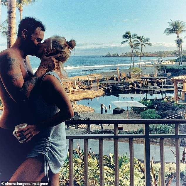 Loved up: Sharna and her Beverly Hills, 90210 actor boyfriend made their romance Instagram official earlier this year, taken during their holiday to Hawaii.She shared a photo of them passionately kissing on a balcony, along with the caption 'him' and a red love heart emoji