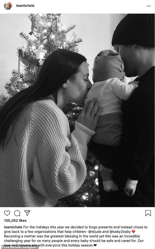 'Becoming a mother was the greatest blessing': Lea shared a black-and-white picture on Christmas Eve of herself kissing the baby as his father held him in his arms