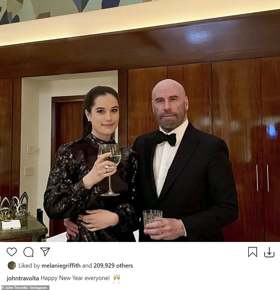 Staying strong: John Travolta, 66, posed in black tie with his 20-year-old daughter Ella and the two raised a glass to wish everyone a Happy New Year. He lost his wife Kelly Preston to cancer in 2020