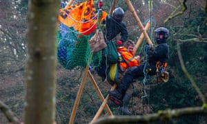 Police climbers pull protester Dan Hooper, aka Swampy, out of a 30-feet high bamboo structure in the River Colne in Denham Country Park.