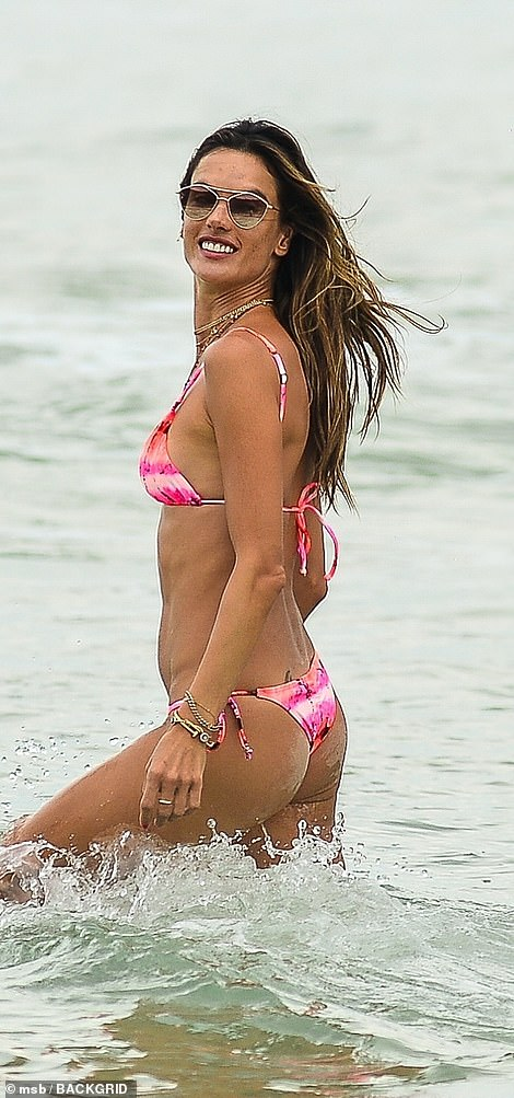 Making a splash: The world-famous model looked like she was in her element as she hit the shores of the city of Florianópolis wearing a tiny pink bikini