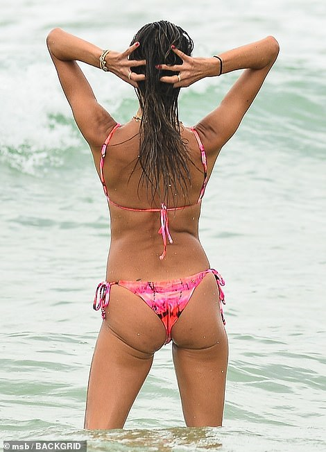 Cheeky: The classic tie-side bottoms featured a cheeky Brazilian backside, flashing tons of flesh as the star waded into the waters
