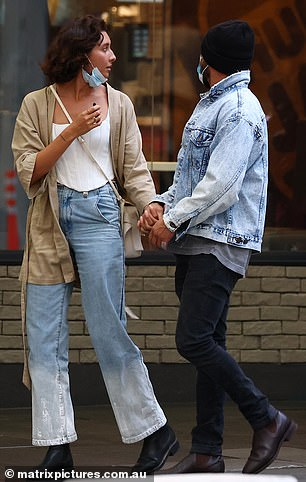 Casual:High School Musical star Zac cut a casual figure in black skinny jeans, which he teamed with a grey shirt and a light blue denim jacket